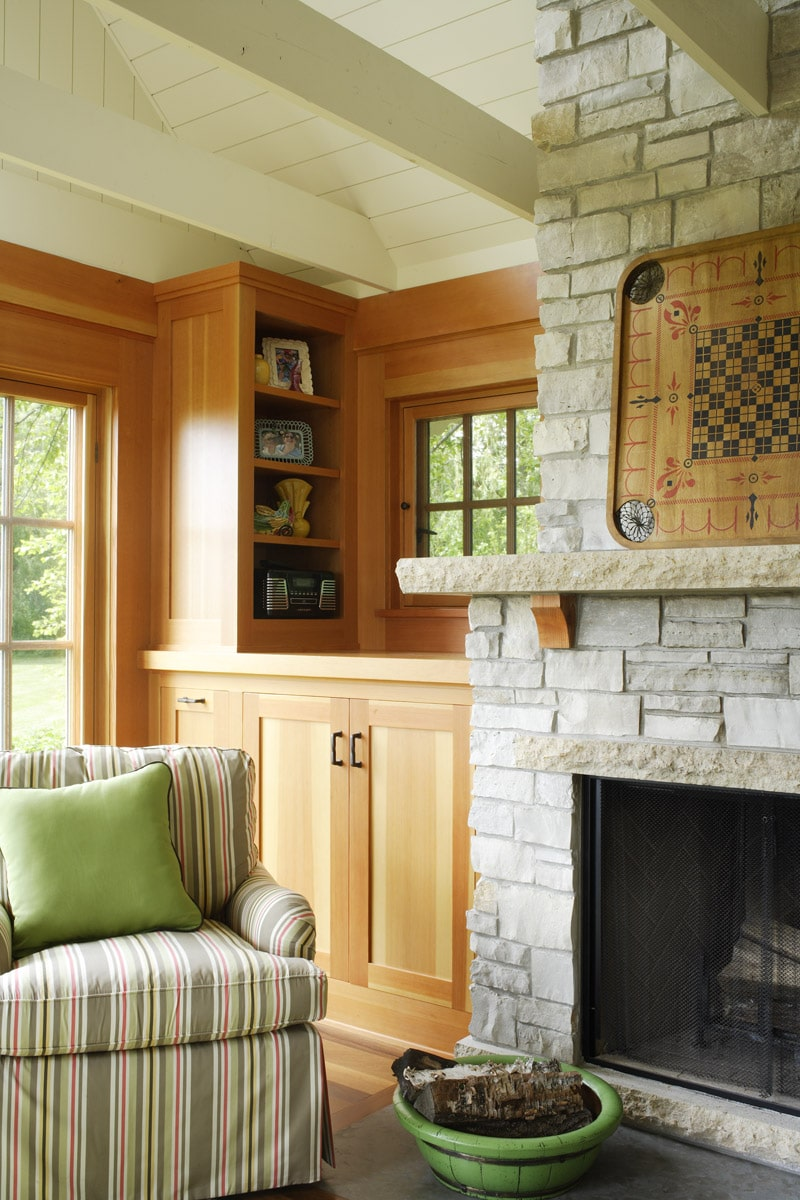 Limestone fireplace in boat house with limestone mantle