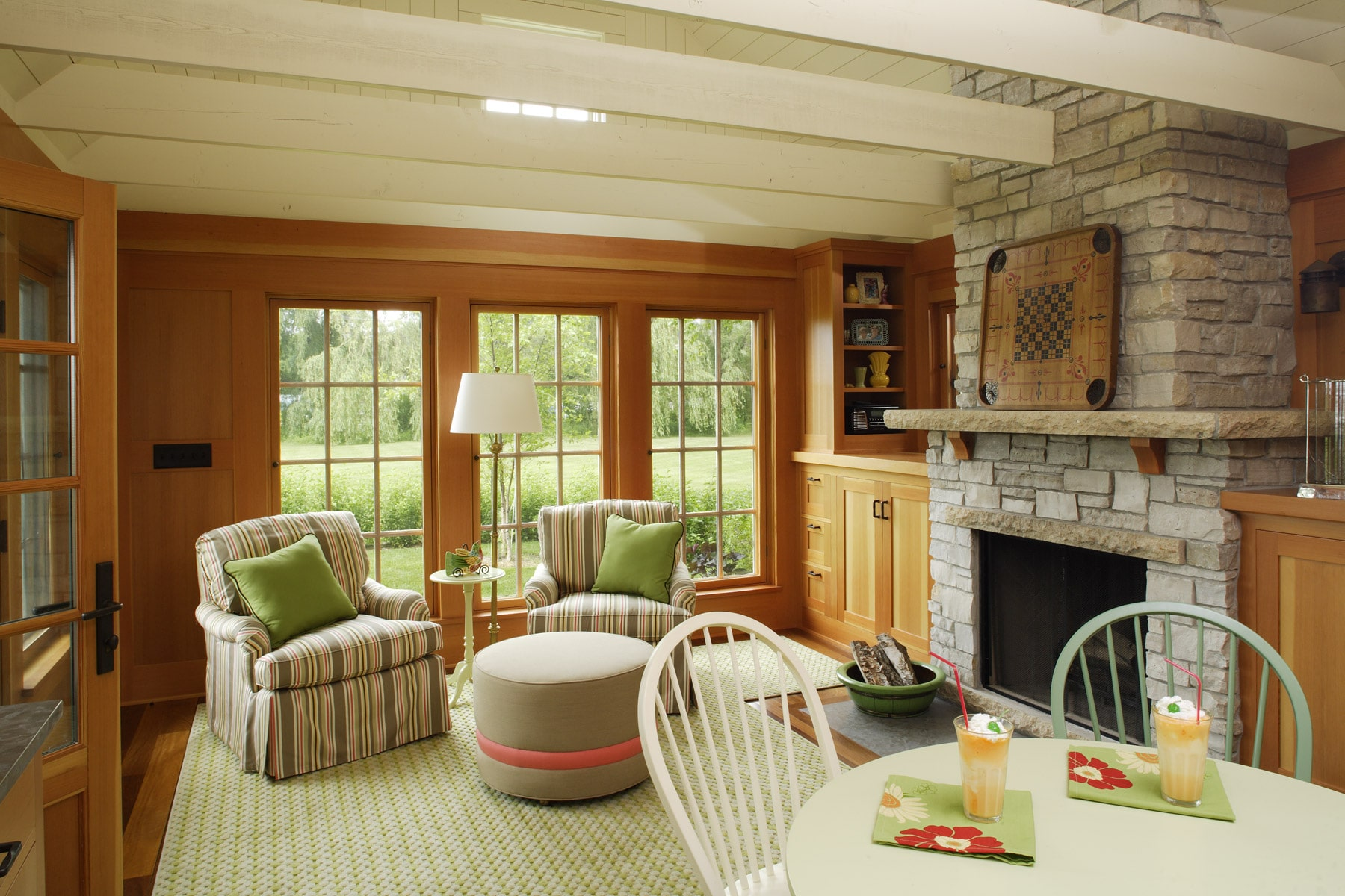limestone masonry fireplace in boathouse with seating and dining