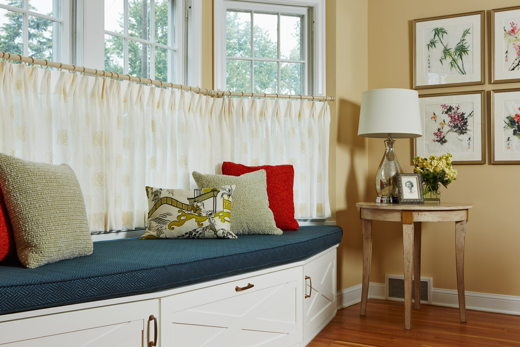 Custom designed built-in window seat with cafe curtains
