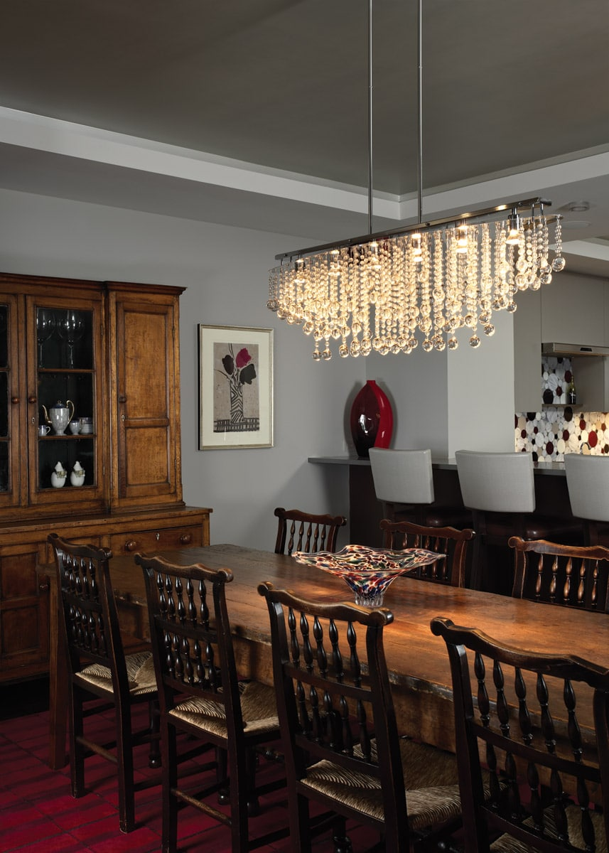 Crystal chandelier in dining room with antique table