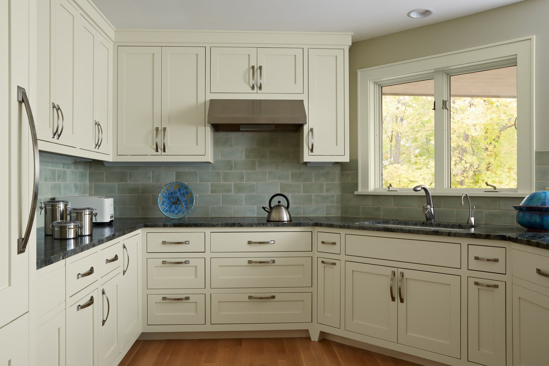 classic kitchen in coastal color palette and cream shaker cabinets