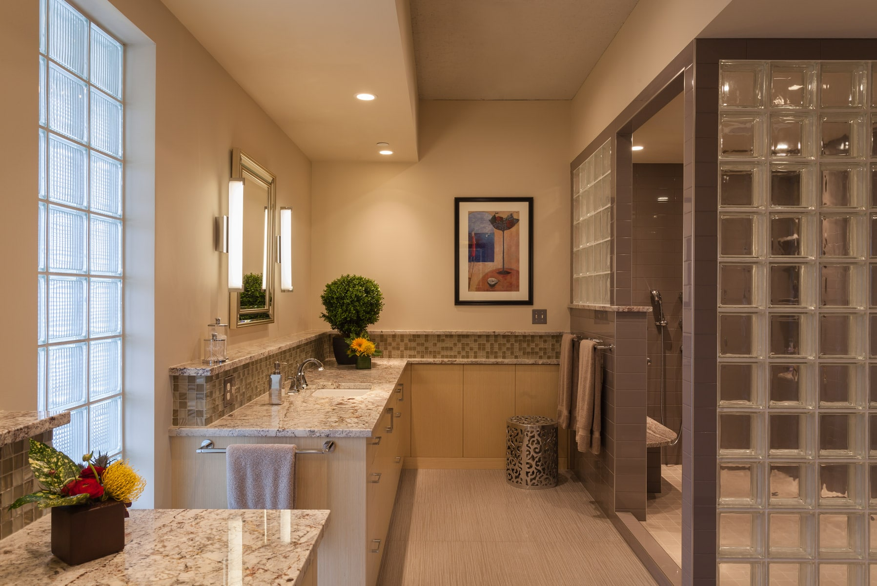 Distinctive penthouse master bath in neutral colors with glass block