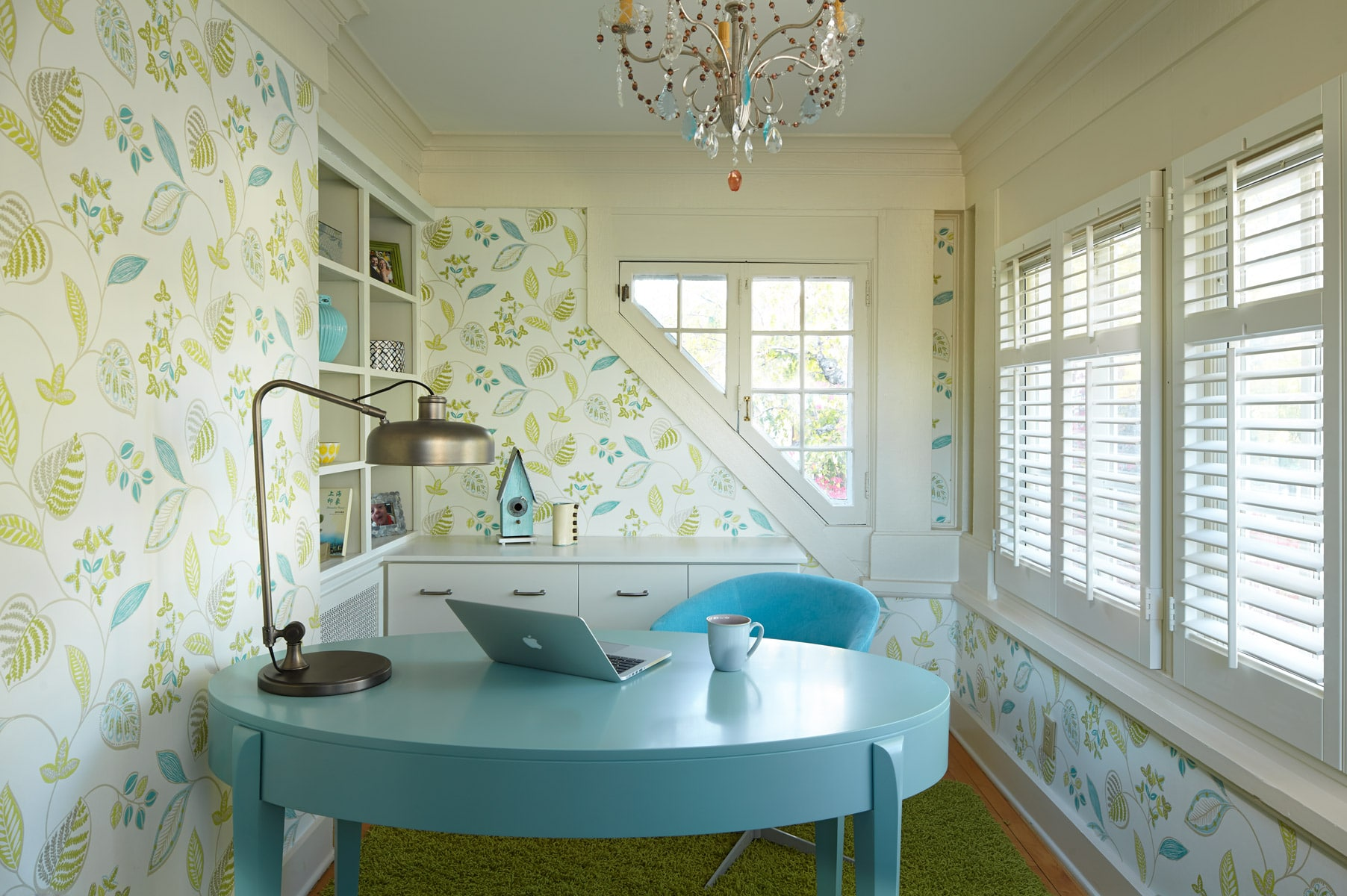 Light Blue oval desk in eclectic feminine home office with crystal chandelier