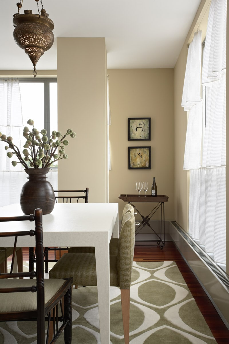 white linen-wrapped table with moroccan light fixture and modern rug