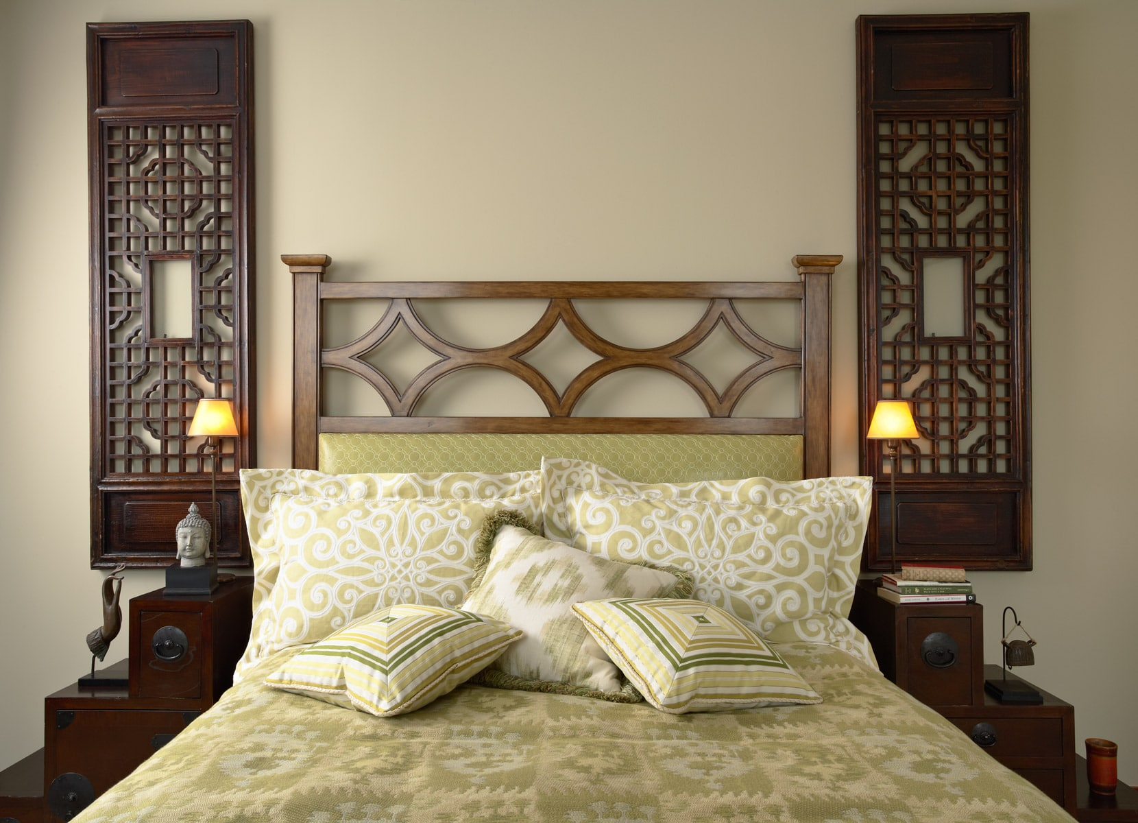 Green master bedroom with temple screens and custom headboard
