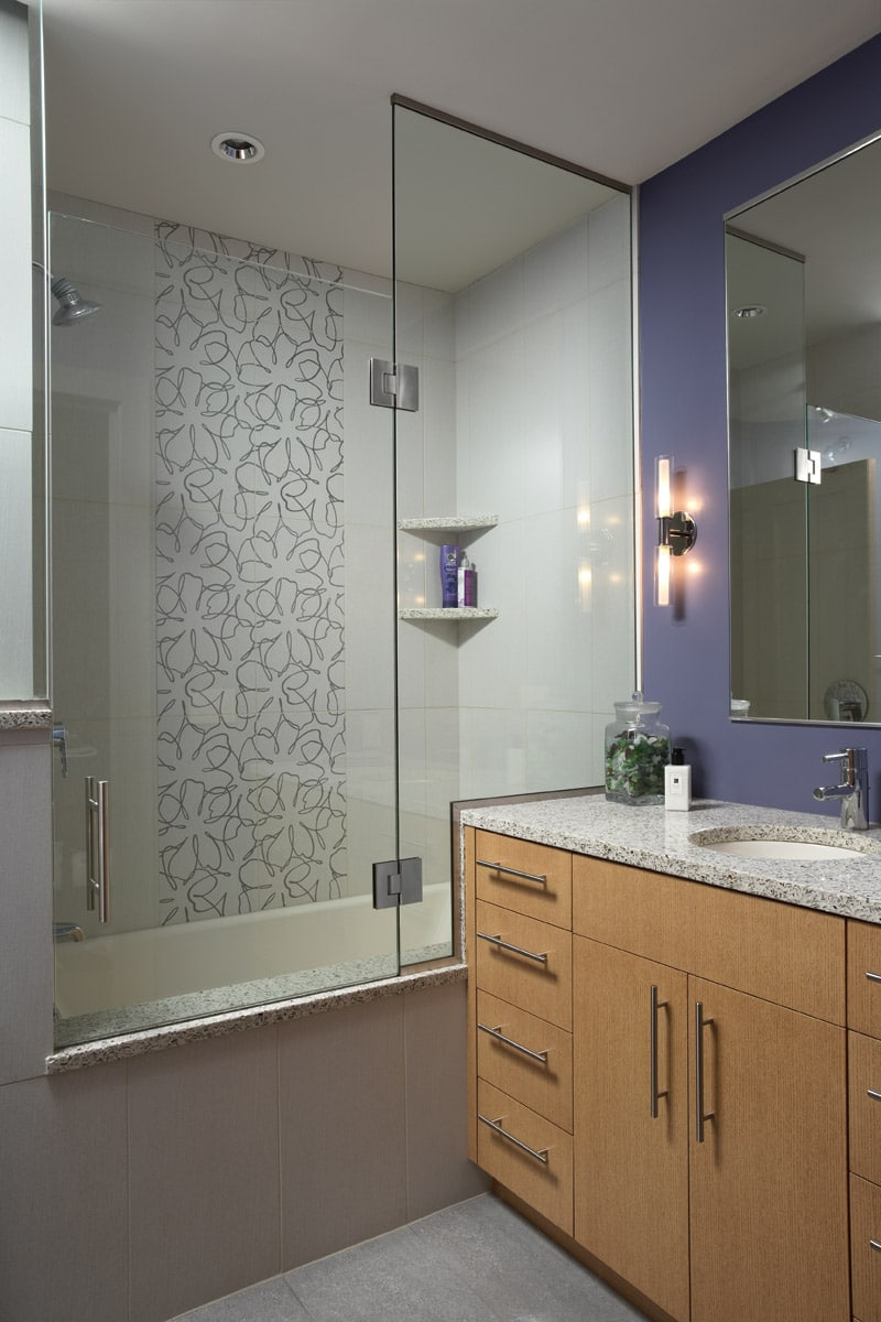 floral tile in bath shower with lavender walls
