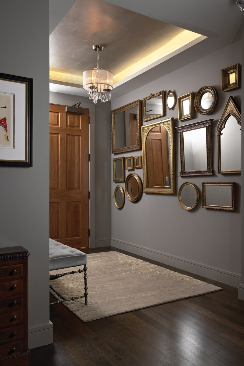 antique mirror collage in modern condominium entry