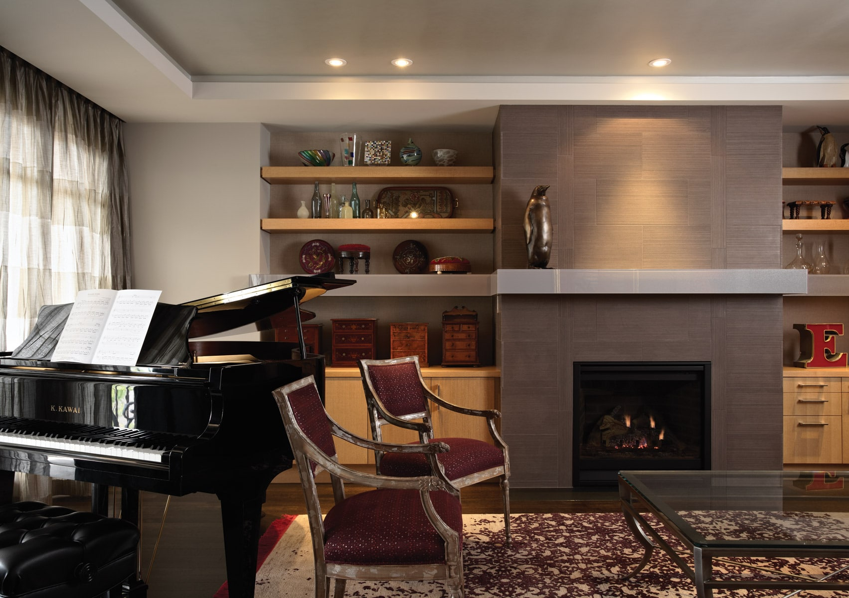 modern gray fireplace with glass mantle and grand piano