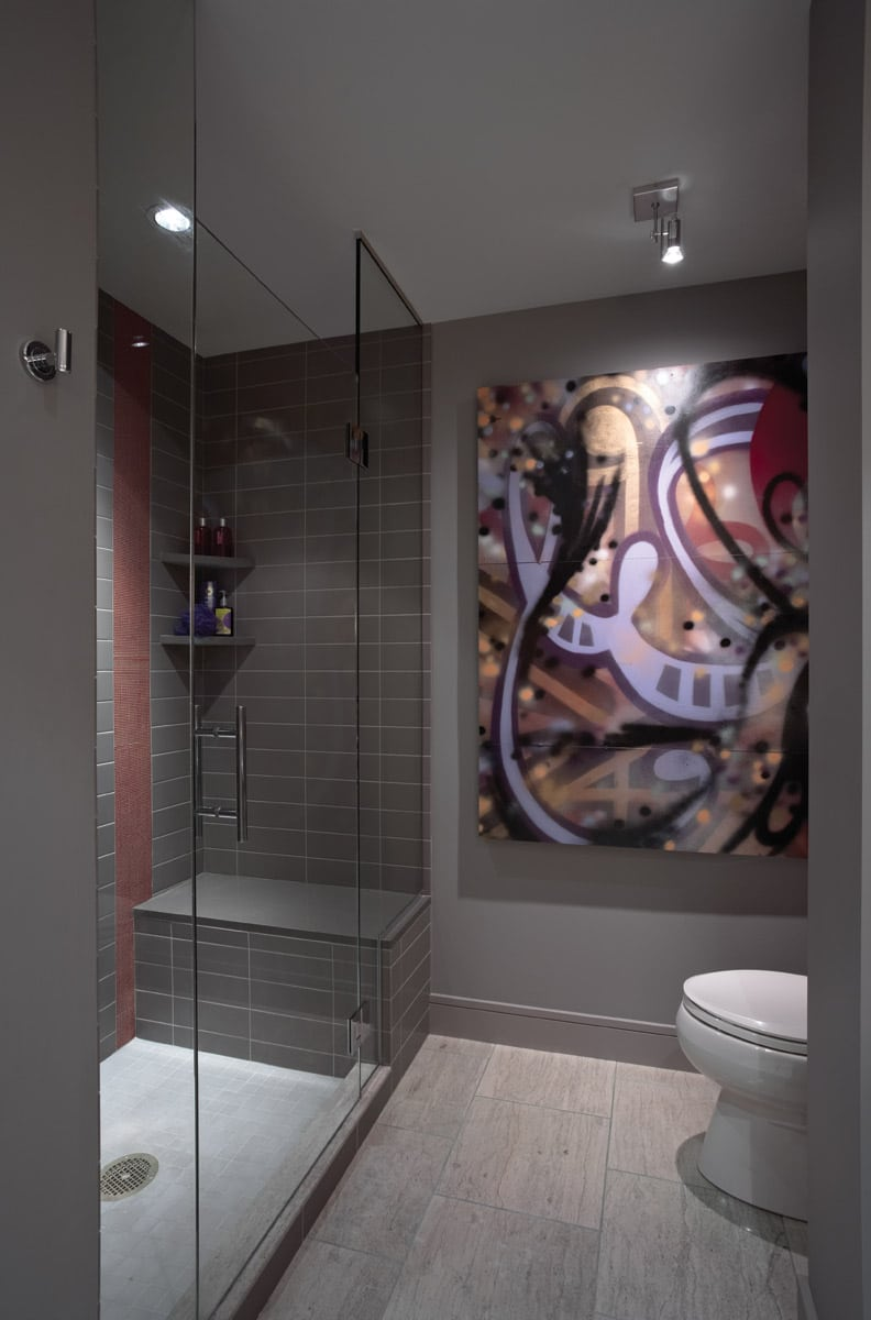 Grey shower with glass doors and red mini-mosiac stripe and original artwork