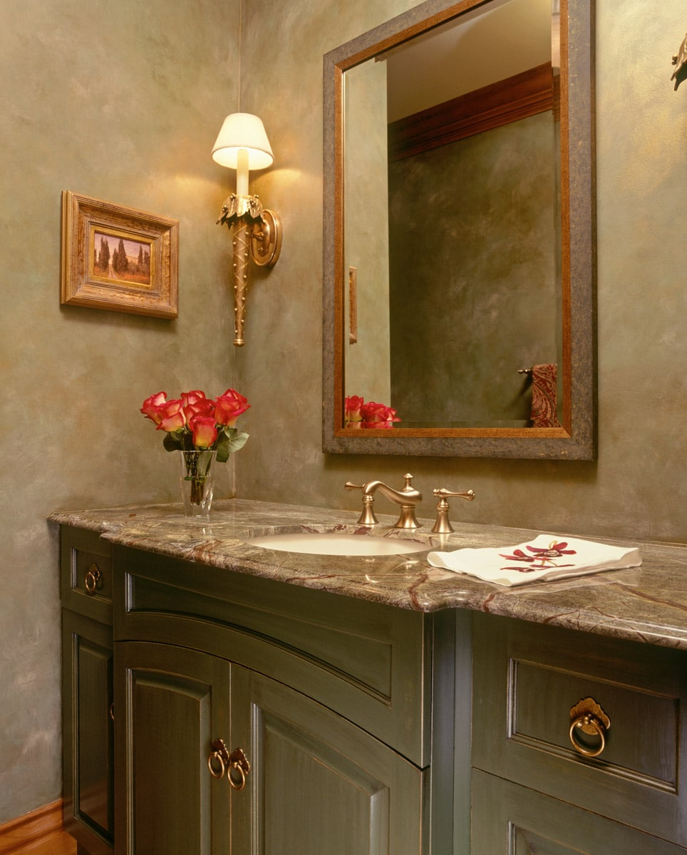 green powder room with furniture-like vanity