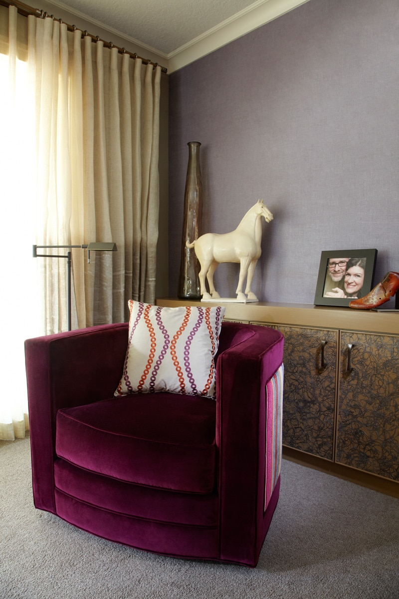 Jewel-toned accents in neutral family room with hand-painted drapery