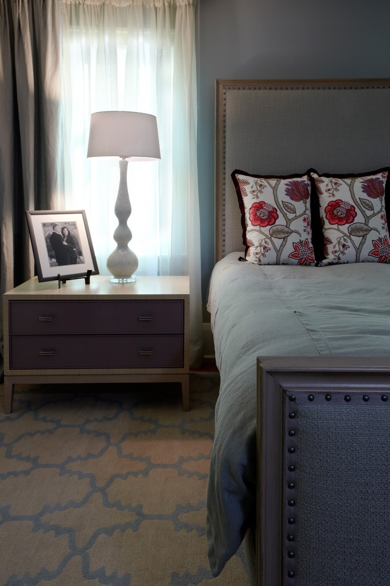 light blue master bedroom with custom night stand in luxury renovated home