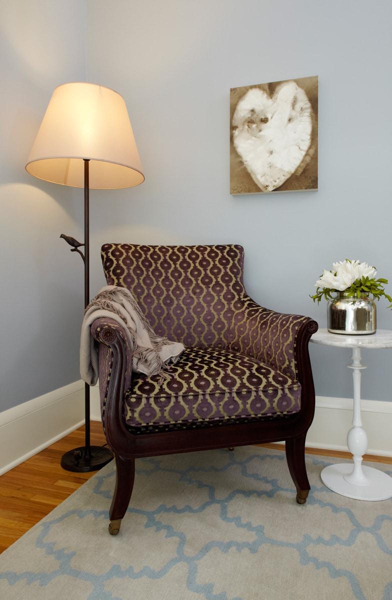 Traditional cut-velvet aubergine chair in renovated luxury master bedroom