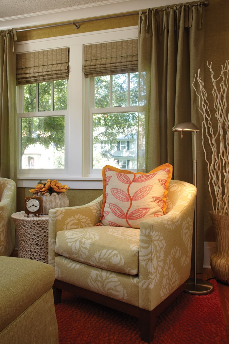 Sitting room with modern green paisley chair and green linen drapery