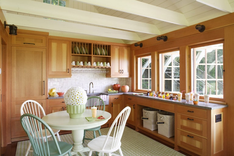 Boat House kitchen with green dining table and farm house sink