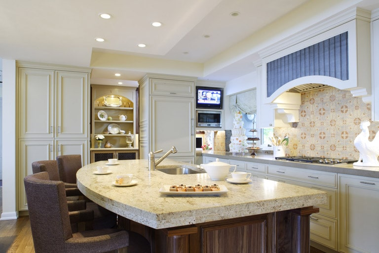 Custom gourmet kitchen cream and walnut cabinets