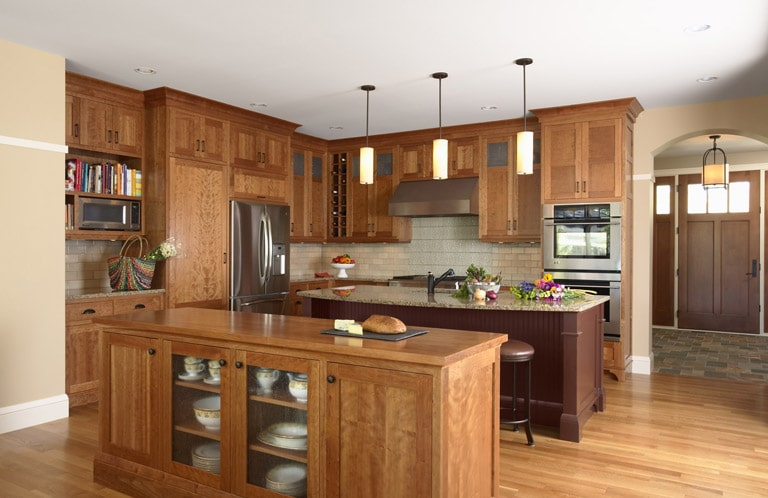 Kitchen with cherry shaker style cabinets and painted island