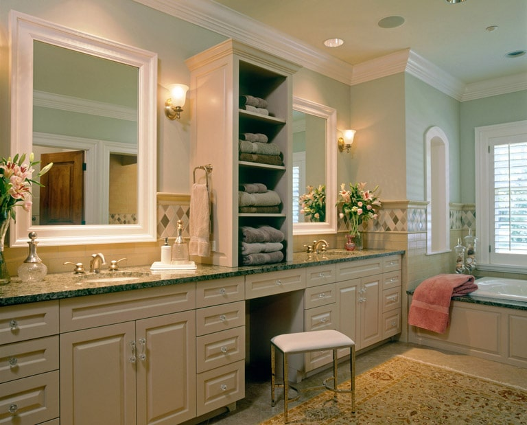 Beige double vanity with tower and hand-made tile backsplash