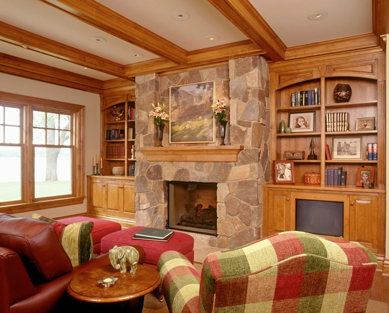 Plaid chairs in sitting room with custom masonry fireplace