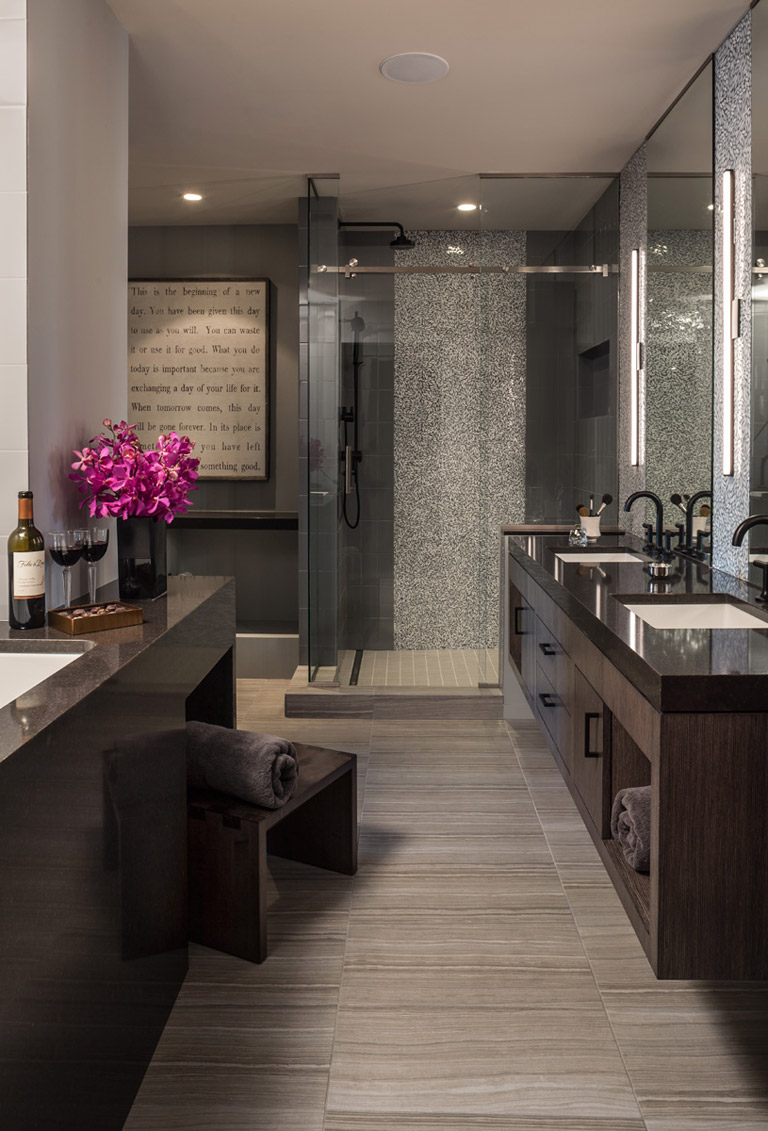 Glass shower and floating double vanity in grey luxury master bathroom