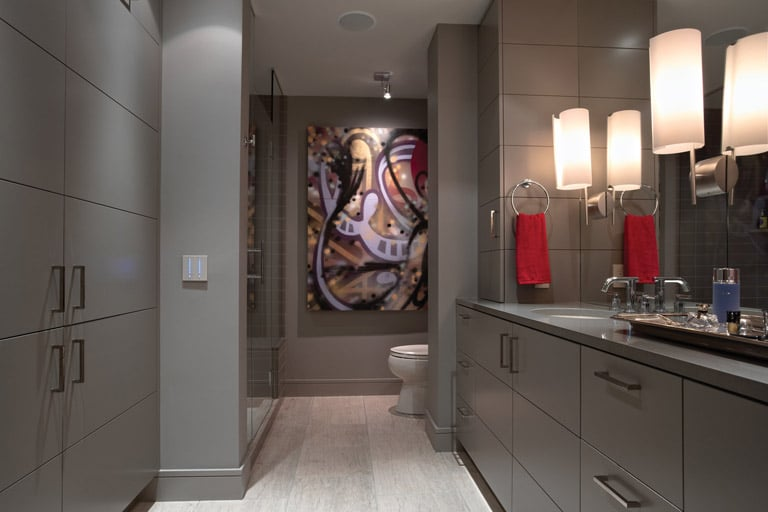 Grey lacquer vanity and cabinetry in luxury condominium master bath