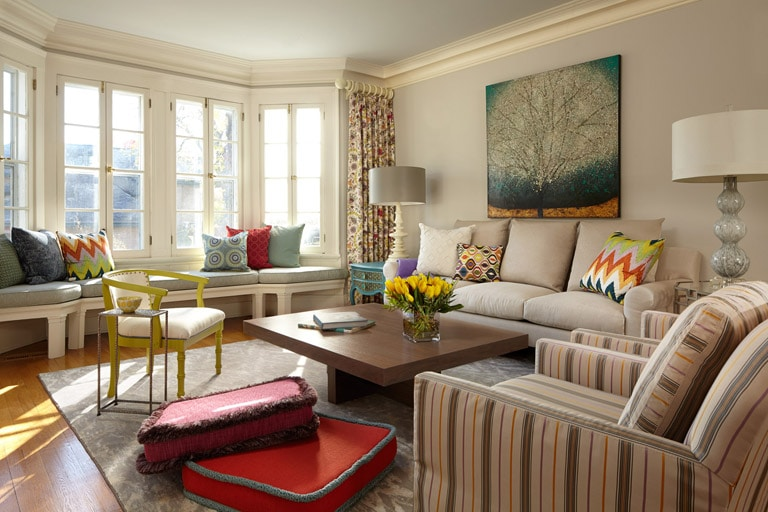 Updated Classic living room with grey color palette, pops of color and floor pillows