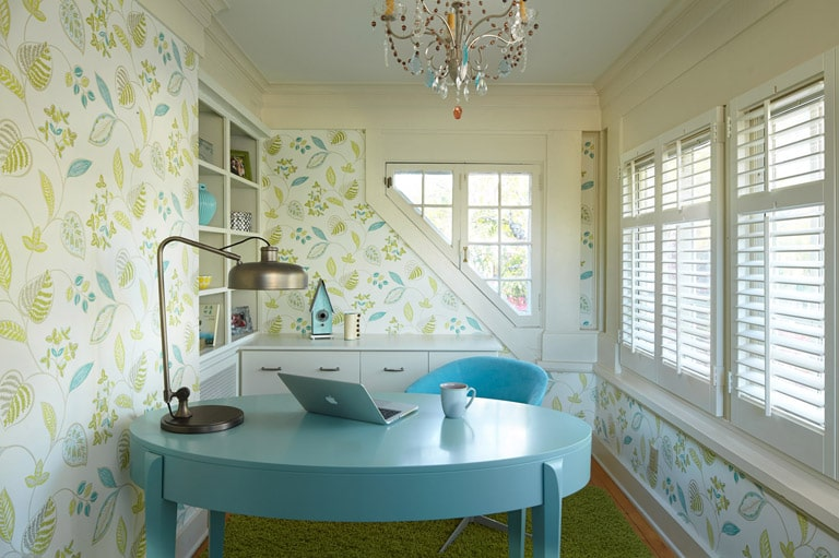 Feminine home office with light blue oval desk