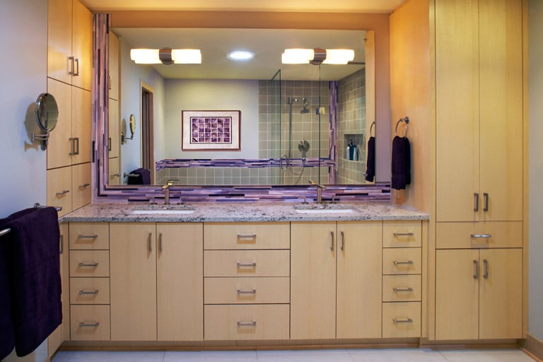 Modern maple double vanity with purple stained glass tile