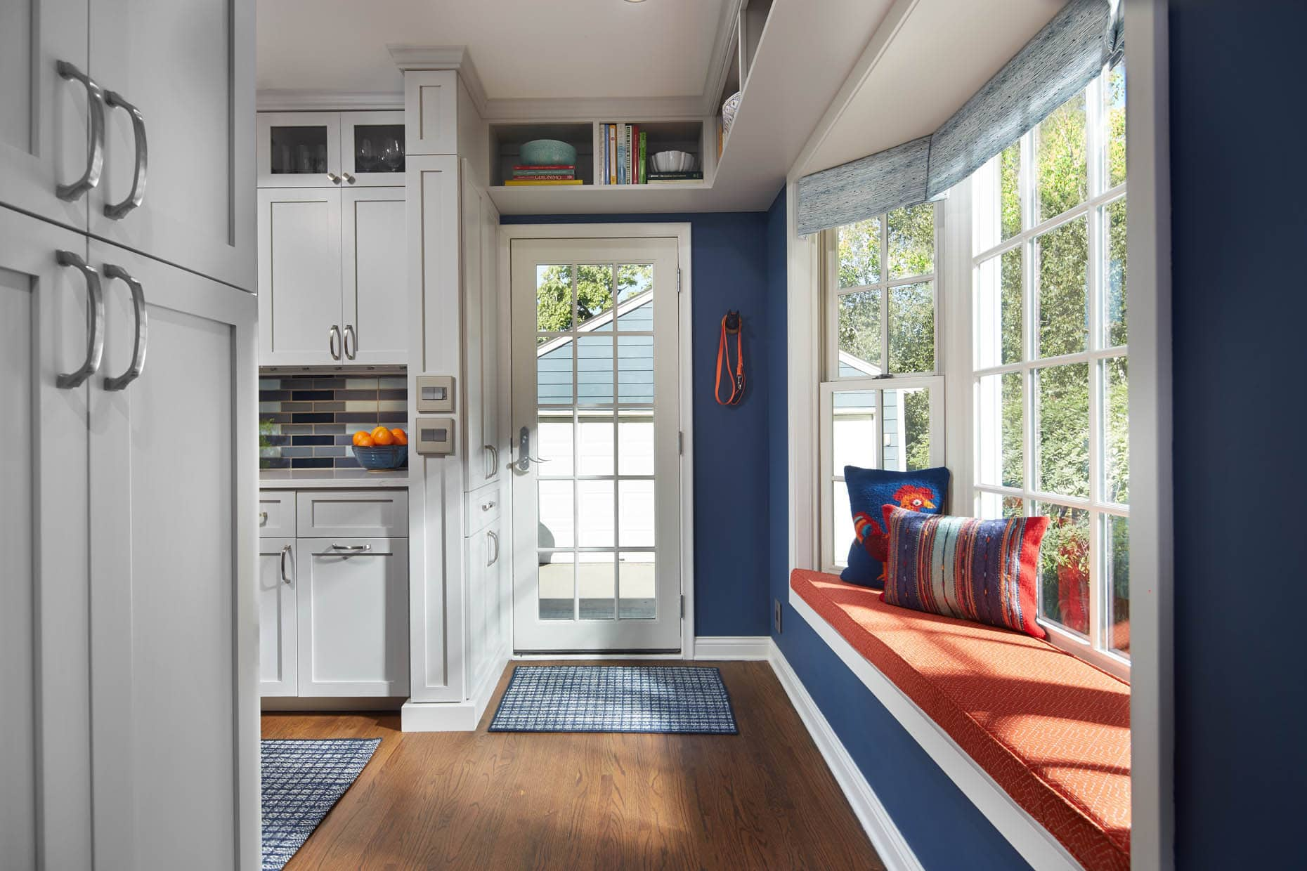 classic-kitchen-window-seat-navy-orange-minneapolis-interior-designer.jpg
